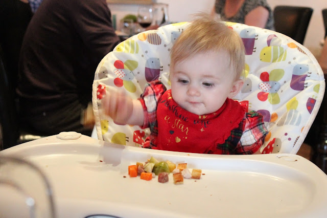 baby eating food at the newbridge on usk