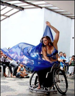 A woman doing a veil performance in a wheelchair. Source unknown