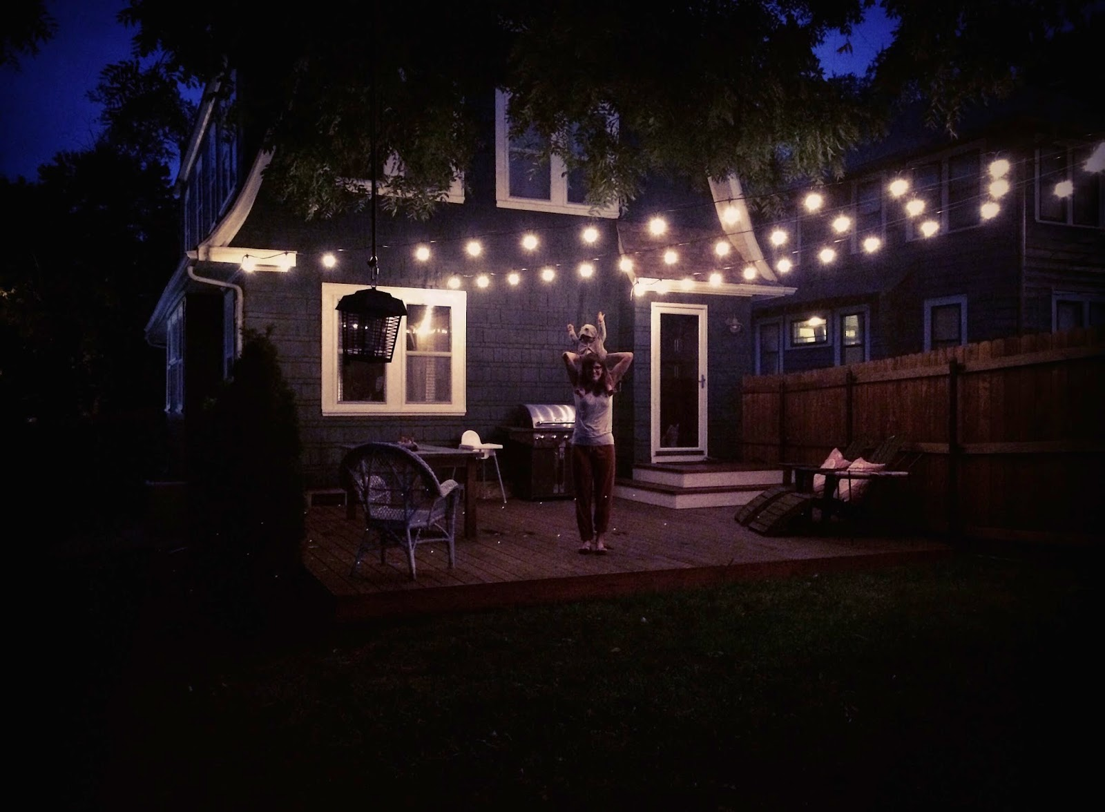 Installing Party Lights In Backyard