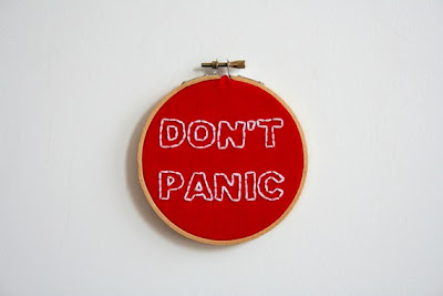 http://www.etsy.com/listing/65817076/hand-embroidery-hoop-dont-panic?ref=sr_gallery_33&ga_search_query=panic&ga_view_type=gallery&ga_ship_to=AU&ga_page=4&ga_search_type=all&ga_facet=panic