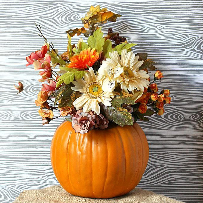 Turn a fake pumpkin into a beautiful floral centerpiece for fall!
