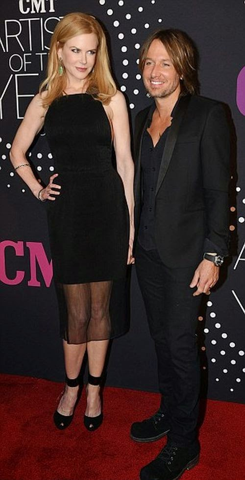 We though we knew which ensemble they were going to wear.  Okay, sure it may be raining, but now that Nicole Kidman have officially arrived the CMT Awards at Nashville, Tennessee on Tuesday, November 2, 2014.