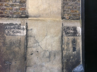 Ghost sign, in a mews entrance near Paddington, London