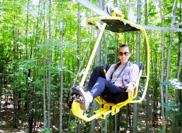 cycling in the air through the forest and over waterfalls, while ...