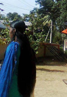 Kerala long hair girl in loose open style.