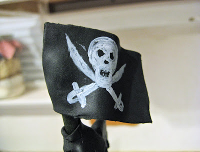 Pirate Ship Cake of The Black Pearl from Pirates of the Caribbean - Close-Up of Fondant Pirate Flag