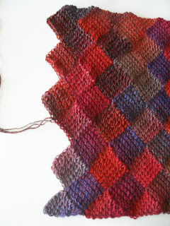 rainbow colored diamonds and triangles in a shawl