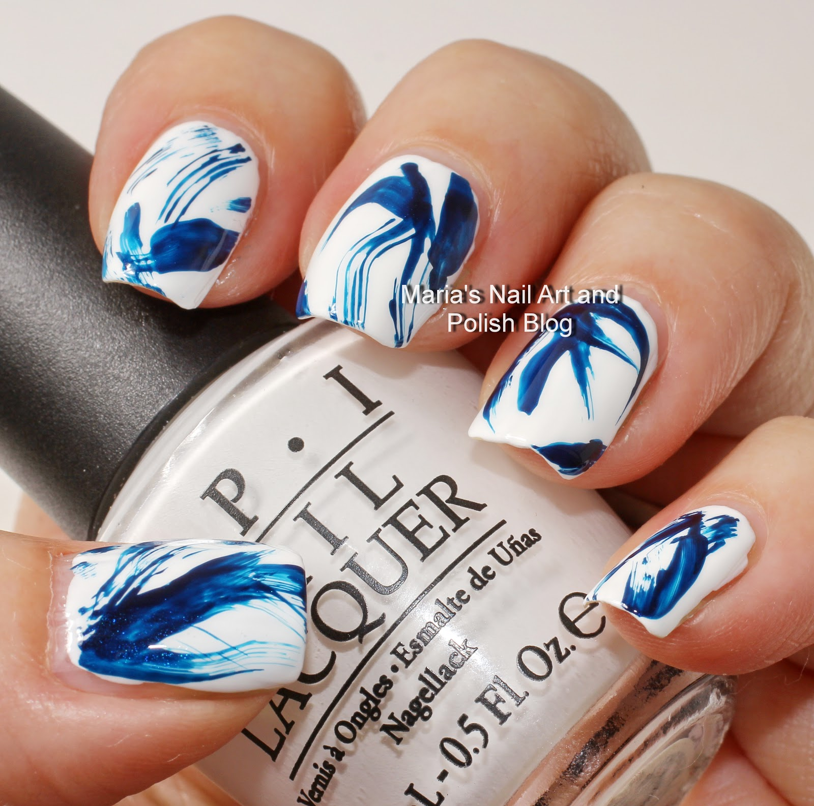 Marias nail art and polish blog blue and white brush stroke nail art stroke nail art the base color is opi alpine snow and i created the blue pattern to match a blouse of mine with the bottle brush of essie midnight prinsesfo Images