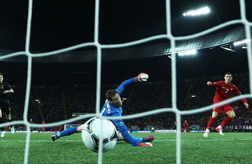 Portuguese winger Cristiano Ronaldo scores the winner past Dutch goalkeeper Maarten Stekelenburg