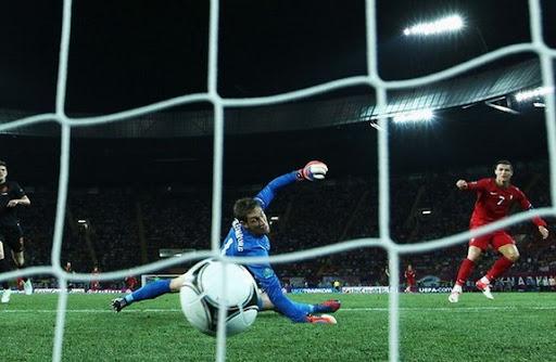 Portuguese winger Cristiano Ronaldo scores the winner past Dutch goalkeeper Maarten Stekelenburg