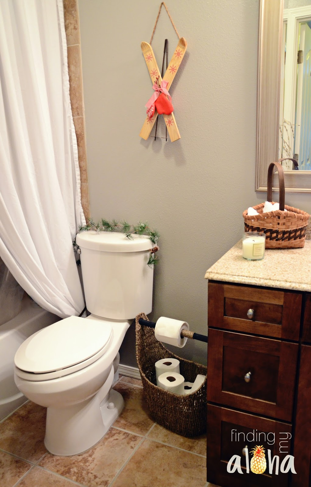 I dressed up the commode with a small piece of garland and hung up the skis on the wall above it  I added a basket of plush washcloths on the counter and. Finding My Aloha  Decorating bathrooms for Christmas   tips  amp  a tour