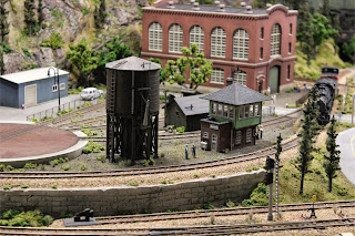 Atlas Signal Tower and Water Tower kits on the edge of the rail maintenance yard