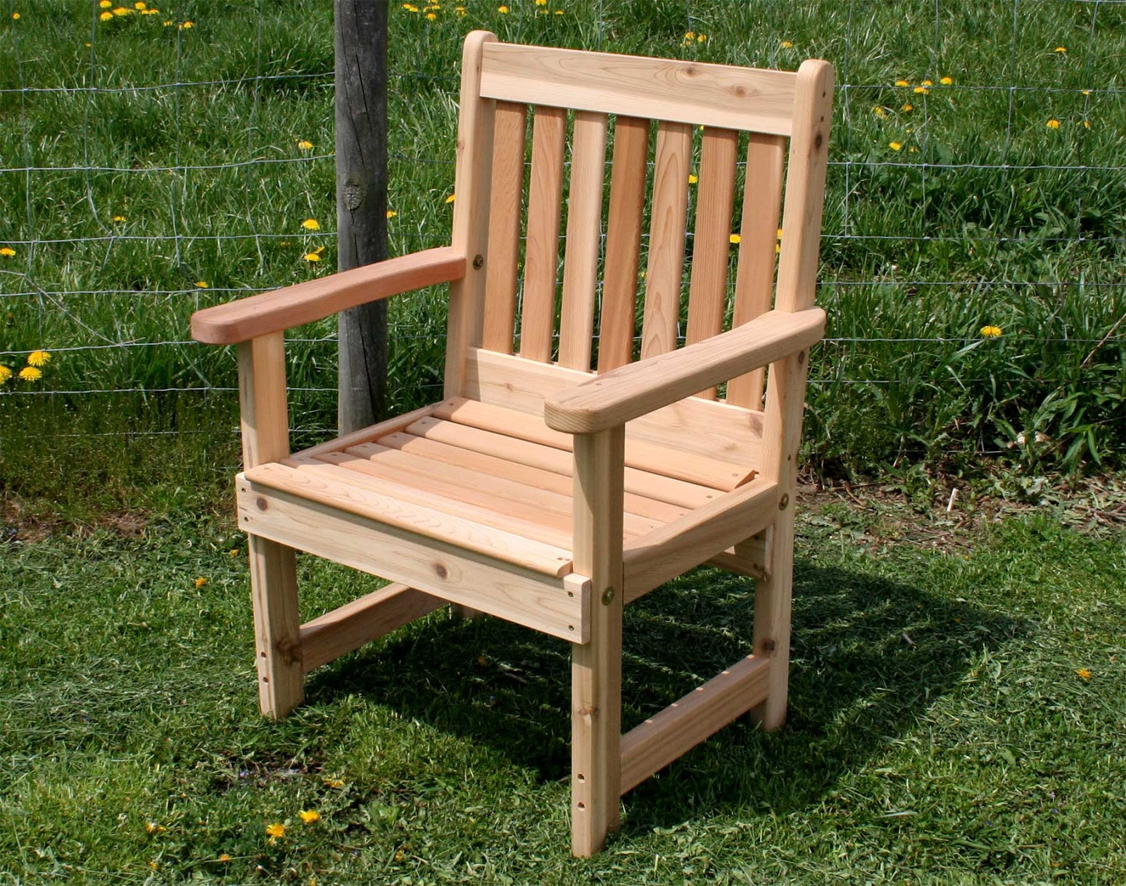 Wooden chairs with armrest - Wooden Chairs With Armrests Simple Shaped With A Right Angle As Seats In General Backrest Made Tenuous Horizontally Arranged So That There Is Air