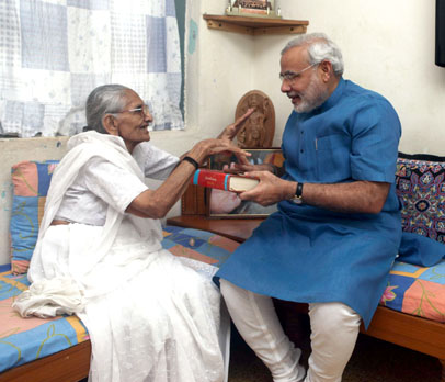 Narender Modi with his Mother giving gift of Bhagwat Geeta to mother