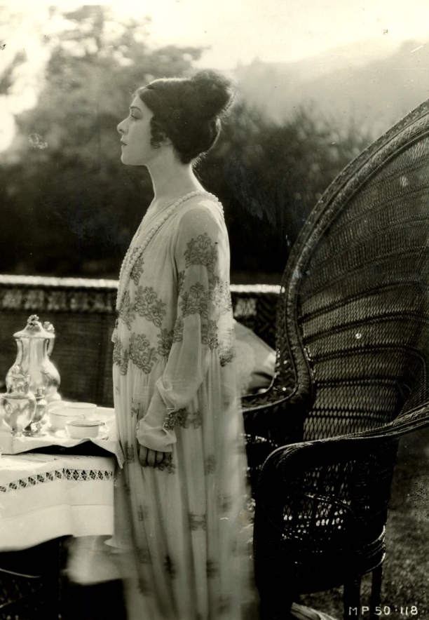 circa 1920s lovely lady in sheer embroidered dress with long pearls