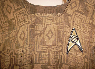 Tunic with Star Trek original-series sciences emblem attached to it