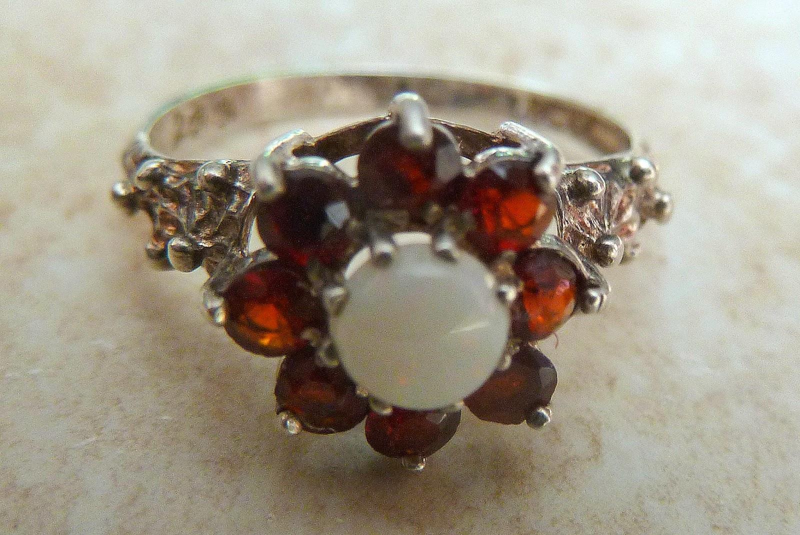 http://www.kcavintagegems.uk/vintage-sterling-silver-garnet-and-opal-ring-358-p.asp