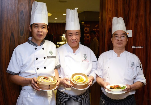 Three of Tim Ho Wan's chef presenting the new dishes to us
