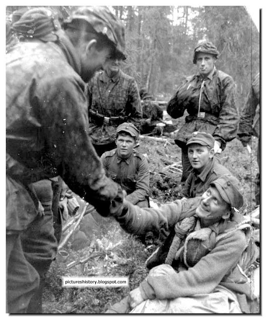 Nordland shakes hand wounded finnish soldier