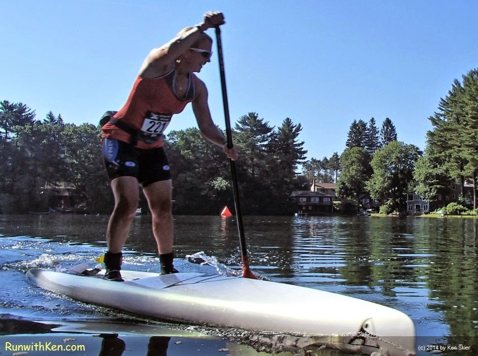 Clos-up action photo of a Stand Up Paddler (SUP) at the XTERRA French River Triathlon in Oxford, MA (June 28, 2014)  Photo by Ken Skier.  (RunwithKen.com)