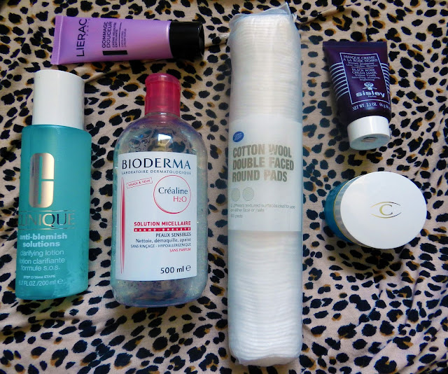 Desert island skincare: Clinique anti-blemish solutions, bioderma micellaire water, cotton pads, lierac gentle scrub, sisley black rose cream mask, clarins hydraquench cream