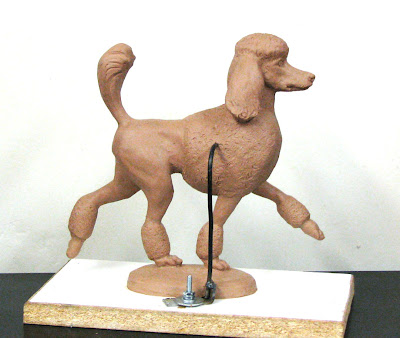 Standard poodle dog figurine by Lena Toritch