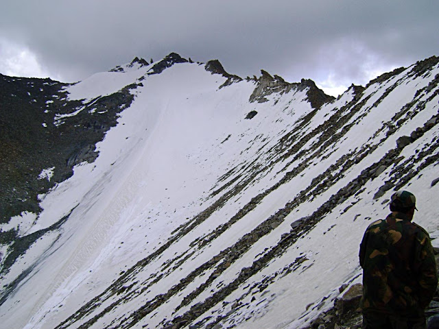 mountain top covered in a sheet of snow