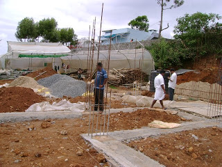House construction in india digging the foundation for Concrete pillars for foundation