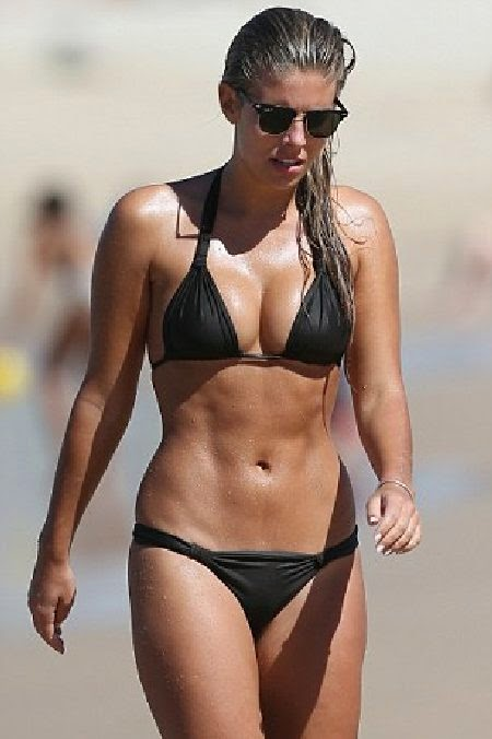 Natasha Oakley goes barefoot in a Black Bikini on vacation in Australia