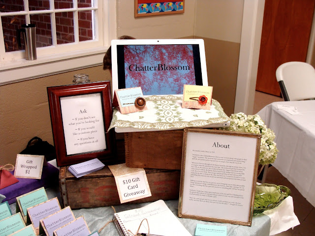 craft fair display table with old crates and vintage feel