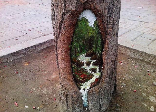 فتاة الصين تقوم بالرسم الأشجار بطريقة رائعة ومبهرة شوارع الصين.