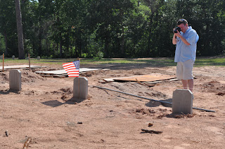 Dr. Wilson photographs a new veteran's grave at the cemetery.