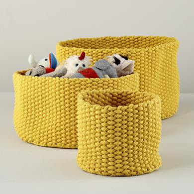 three yellow rope baskets, different size