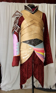 Paper patterns of the Elrond armor on the dress form.