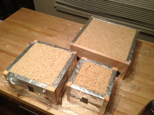 Here Are The Krispy Tiers All Snug In Their Packed Frames. It Took 19  Batches Of Rice Krispy Treats To Fill These Suckers!!!