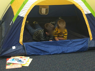 reading in a tent (Brick by Brick)