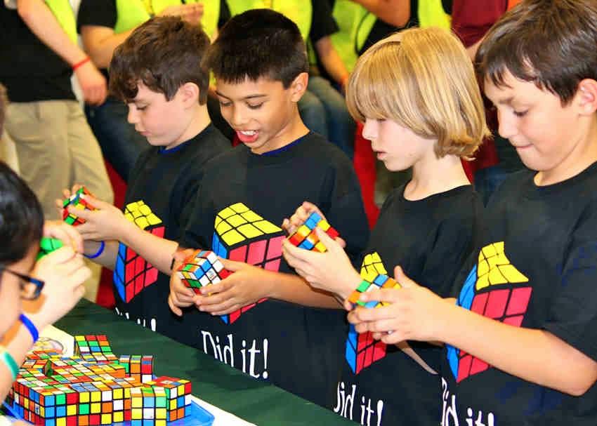 Kids solving Rubik's Cube