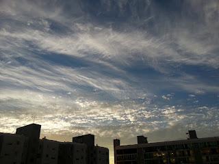 Wispy clouds on a blue sky