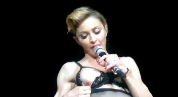 Madonna flashes nipple