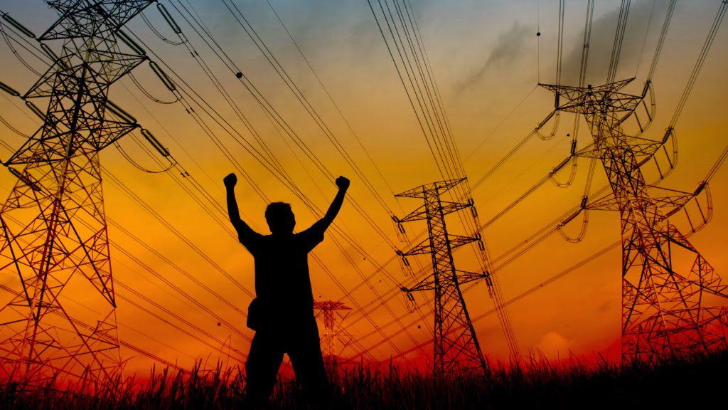 Power lines and man (Credit: Shutterstock) Click to Enlarge.