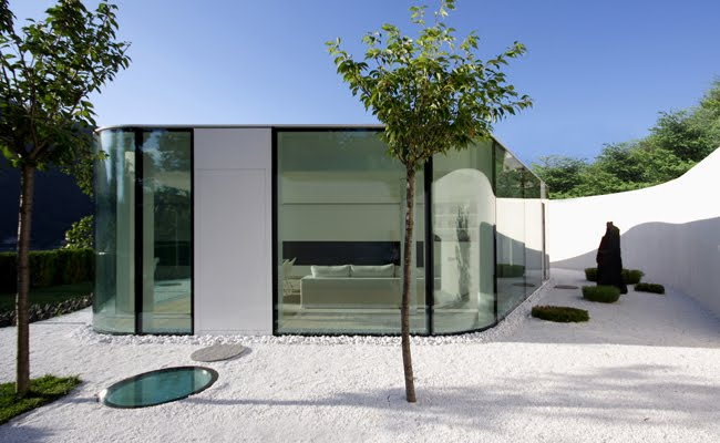 Gently curved glass house modern design by for Modern villa architecture design