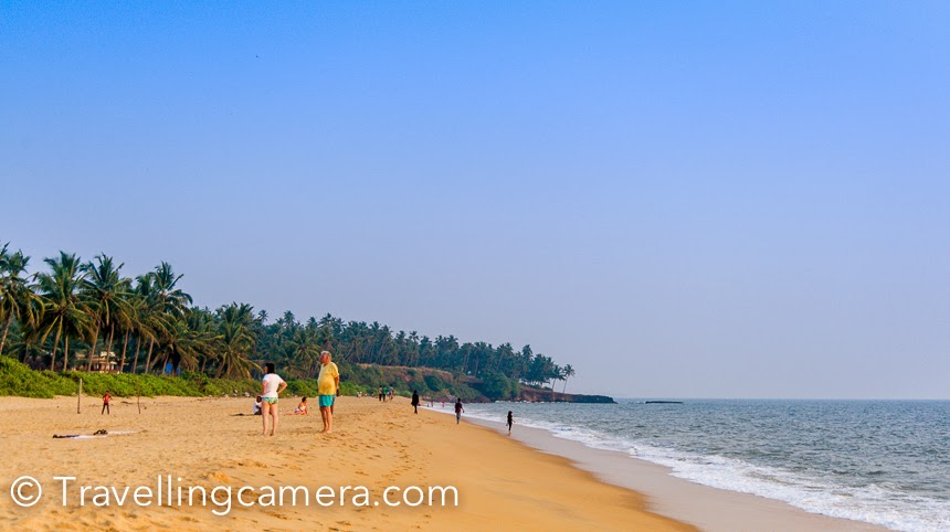During our Kerala trip, we planned to se Theyyam festival in Kannur and stayed around Thottada beach. This is a beautiful beach in Kannur district of Kerala, south India. This Photo Journey shares some photographs of Thottada beach and our experiences of this place.Thottada Beach is located 2.5 km from the NH 17 which connects Kannur  town and Thalassery. It's approximately 1 kilometer long beach, which is not very crowded. Lot of friegners can be seen around the beach, either playing or sun bathing. There are quite a few beach houses around Thotadda.The Thottada river (a small one) flows into one end of the beach. There is also a dam/bund built across the river 3 decades ago to keep the fresh water from salt water. Away from the sea the river spreads to form swamps which makes a great habitat for various birds and fishes. More about the beach can also be checked at We also stayed around the beach and hence spent most of the time around it. Early in the morning, all the fishermen boats start from the beach but you need to reach there in dark to witness the real action. I don't have any photograph from the morning when all the fishermen start their journey towards the sea. Evenings are most happening on the beach when most of the tourists enjoy playing with waves. We also had fun watching crabs coming out from the sand-holes and picked by birds. I have a very shaky video wherein birds are continuously targeting sand-holes after the waves go off from the beach. And they target the small crabs, as they come out. These small crabs walks extremely fast but still birds win most of the time. Probably they understand the pattern well. Kids from fishermen village can be seen playing football on Thoattada beach and many times, their game gathers lot of audience and suddenly it starts looking like a stadium.Sunsets at Thottada beach were not very interesting :). I think goa sunsets spoiled it for us. We had very high expectations and probably it was not the right time as well. I am sure that monsoons would offer much better sunset views at Thottada beach. Whenever we walked around the beach, we always kept an eye on these birds. Flocks of these birds kept flying around the waves. They remain closer to the wave and immediately attach small crabs who had just landed on the beach. During our two days at Thottada beach, we noticed lot of kids using fancy equipments to build different structures. Since I was not carrying camera everytime to the beach, so I missed clicking those beautiful creations of kids.Most of the folks in the evening wait for sunset and as sun goes down, suddenly whole beach looks empty. Thottada beach was clearly visible from our room as well. Sounds of the sea in the evening were awesome and we spent most of our time in balcony only. But we had to switch off the lights of the balcony to avoid insects who keep wandering around the light sources. You may also want to check - Banasur Sagar Dam, Wayanad - A perfect place for a long walk in the morning || Kerala Diaries Curuva(Kuruva) Island - A potential paradise for nature lovers A Daunting Trek to Edakkal Caves in Wayanad || Kerala Diaries Treasure Trove in Wayanad - our temporary home amid coffee plantation || Kerala Diaries Drive back to Bengaluru from Kannur through scenic Coorg || Kerala Diaries In the presence of Theyyams in Kannur || Kerala Diaries Flying through the western ghats towards Kannur || Kerala Diaries