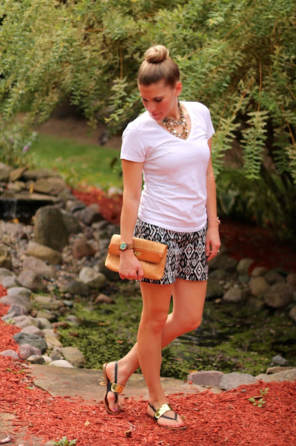 white tee, black and white printed shorts