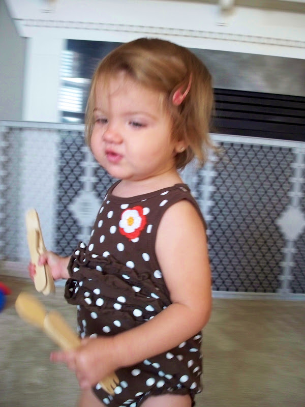 One year old with silverware natural toys