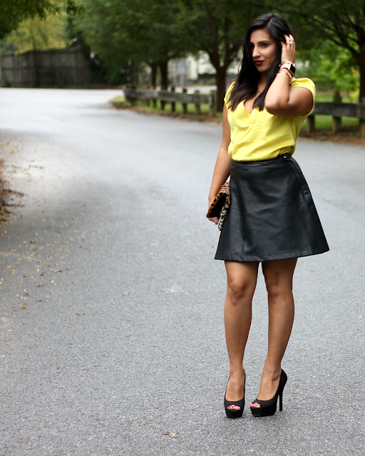 faux leather skirt, yellow satin blouse, leather skirt, a line leather skirt, leopard clutch, clare v, clare v clutch, kat von d vampira