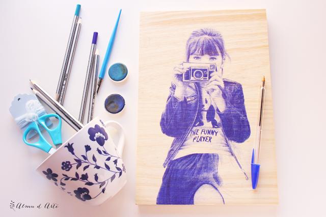 Dibujo sobre madera con boli bic azul