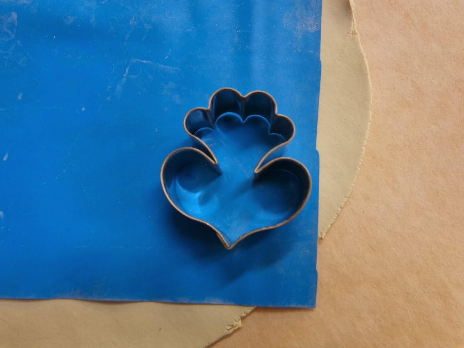 Gumpaste flower petal cutter on rubber exercise band on thin porcelain on SlabMat