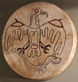 Miskwaabik Animikii painting on drum head of Thunderbird and the Great Horned Underwater Serpent