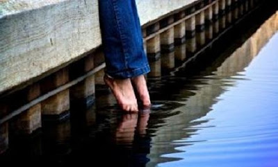 The Icy Waters Of Online Dating  - feet legs foot into water