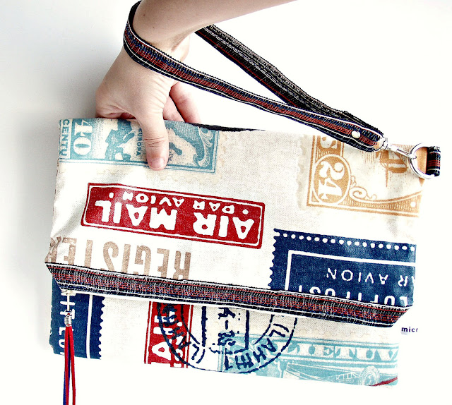Airmail Zipped Retro Stamp Marks Wristlet Pouch by microbio